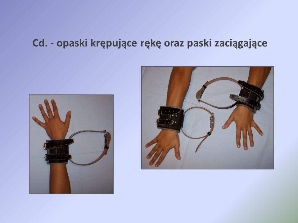 Cd. - opaski krępujące rękę oraz paski zaciągające
