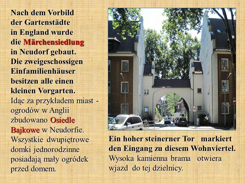 Ein hoher steinerner Tor markiert den Eingang zu diesem Wohnviertel. Wysoka kamienna brama otwiera wjazd do tej dzielnicy. Nach dem Vorbild der Garten
