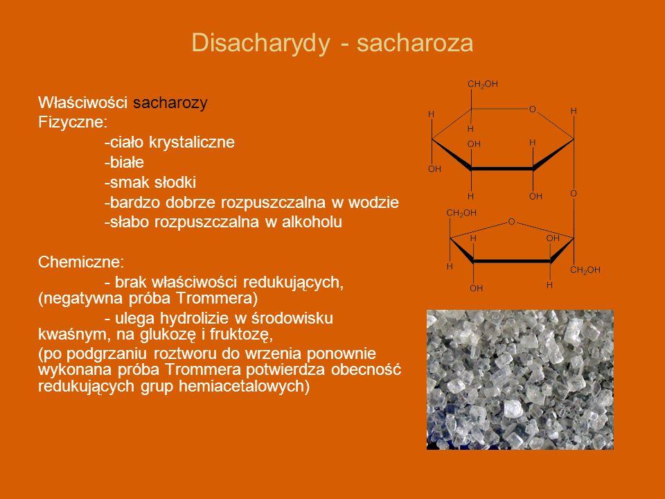 Disacharydy - sacharoza Właściwości sacharozy Fizyczne: -ciało krystaliczne -białe -smak słodki -bardzo dobrze rozpuszczalna w wodzie -słabo rozpuszcz
