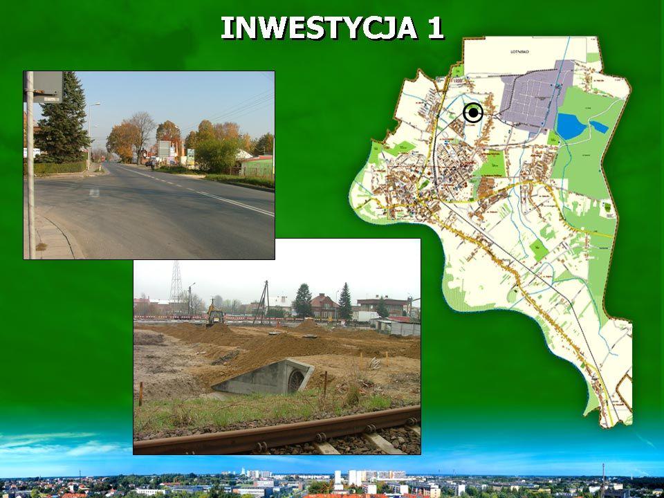INWESTYCJA 1 Realizowano: roboty ziemne, przekładki uzbrojenia, modernizację rowu odpływowego do rzeki Wisłoki, budowę kanalizacji deszczowej.