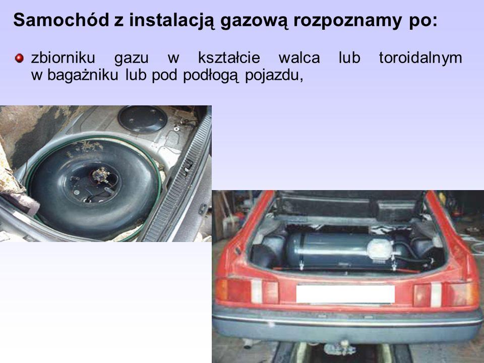 Samochód z instalacją gazową rozpoznamy po: zbiorniku gazu w kształcie walca lub toroidalnym w bagażniku lub pod podłogą pojazdu,