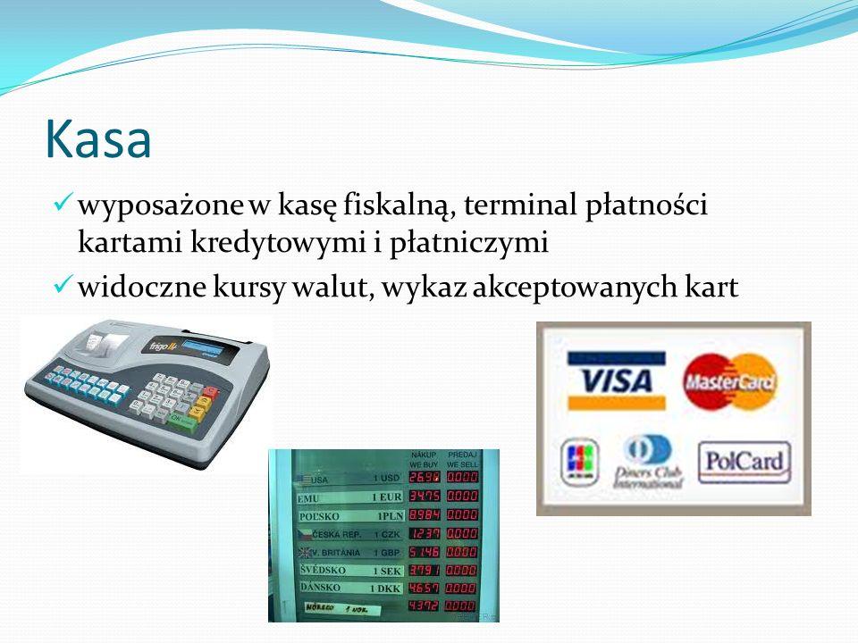 Kasa wyposażone w kasę fiskalną, terminal płatności kartami kredytowymi i płatniczymi widoczne kursy walut, wykaz akceptowanych kart