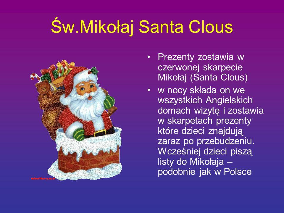Św.Mikołaj Santa Clous Prezenty zostawia w czerwonej skarpecie Mikołaj (Santa Clous) w nocy składa on we wszystkich Angielskich domach wizytę i zostaw