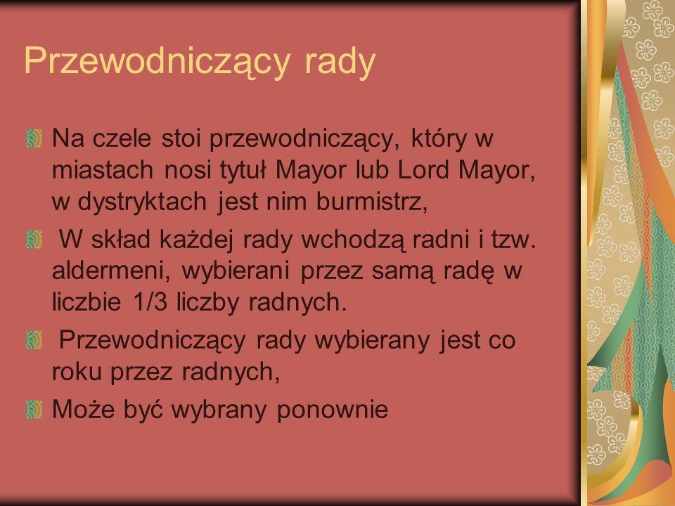 Przewodniczący rady Na czele stoi przewodniczący, który w miastach nosi tytuł Mayor lub Lord Mayor, w dystryktach jest nim burmistrz, W skład każdej r