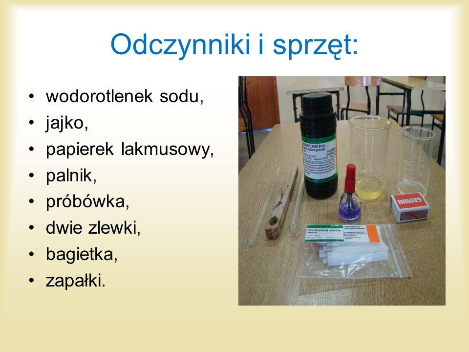 Odczynniki i sprzęt: wodorotlenek sodu, jajko, papierek lakmusowy, palnik, próbówka, dwie zlewki, bagietka, zapałki.