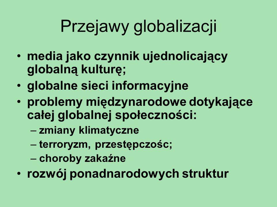Przejawy globalizacji media jako czynnik ujednolicający globalną kulturę; globalne sieci informacyjne problemy międzynarodowe dotykające całej globaln