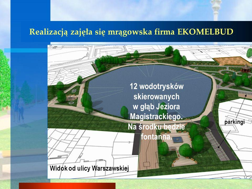 Widok od ulicy Warszawskiej 12 wodotrysków skierowanych w głąb Jeziora Magistrackiego. Na środku będzie fontanna. parkingi Realizacją zajęła się mrągo