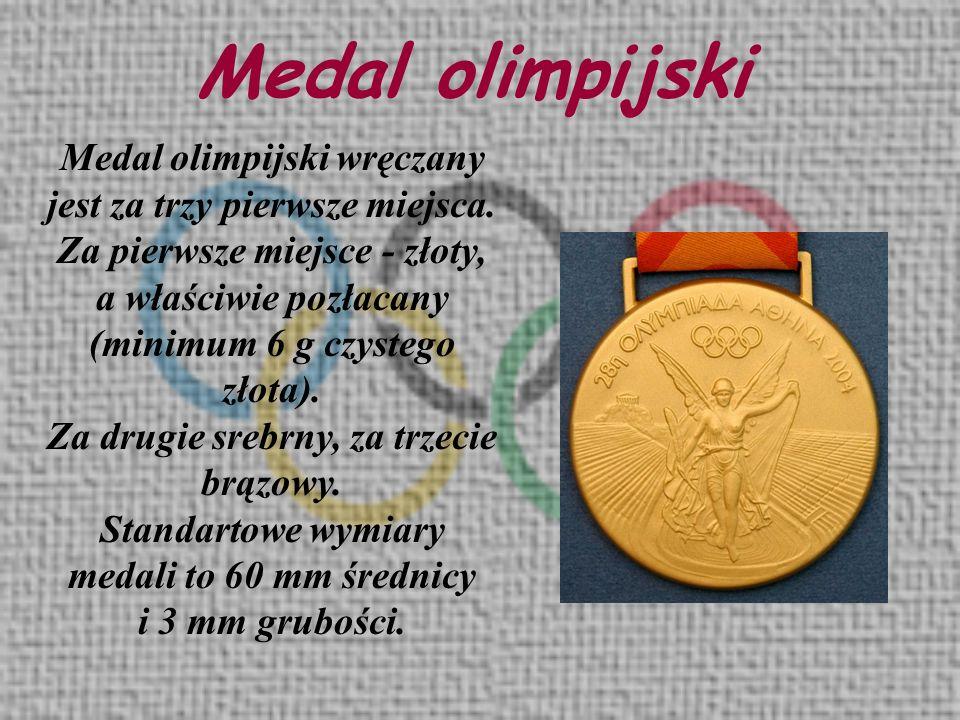 Medal olimpijski Medal olimpijski wręczany jest za trzy pierwsze miejsca. Za pierwsze miejsce - złoty, a właściwie pozłacany (minimum 6 g czystego zło