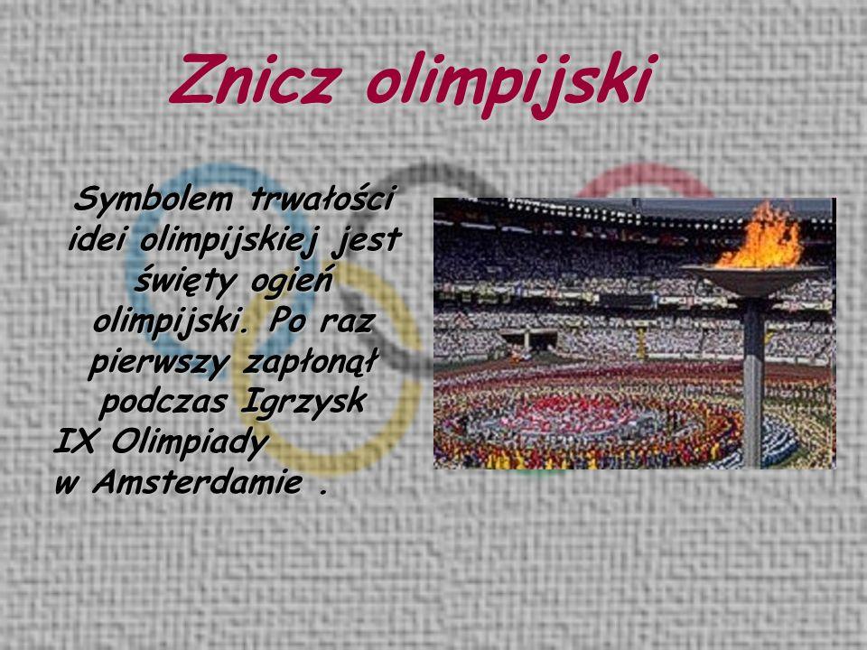 Znicz olimpijski Symbolem trwałości idei olimpijskiej jest święty ogień olimpijski. Po raz pierwszy zapłonął podczas Igrzysk IX Olimpiady w Amsterdami