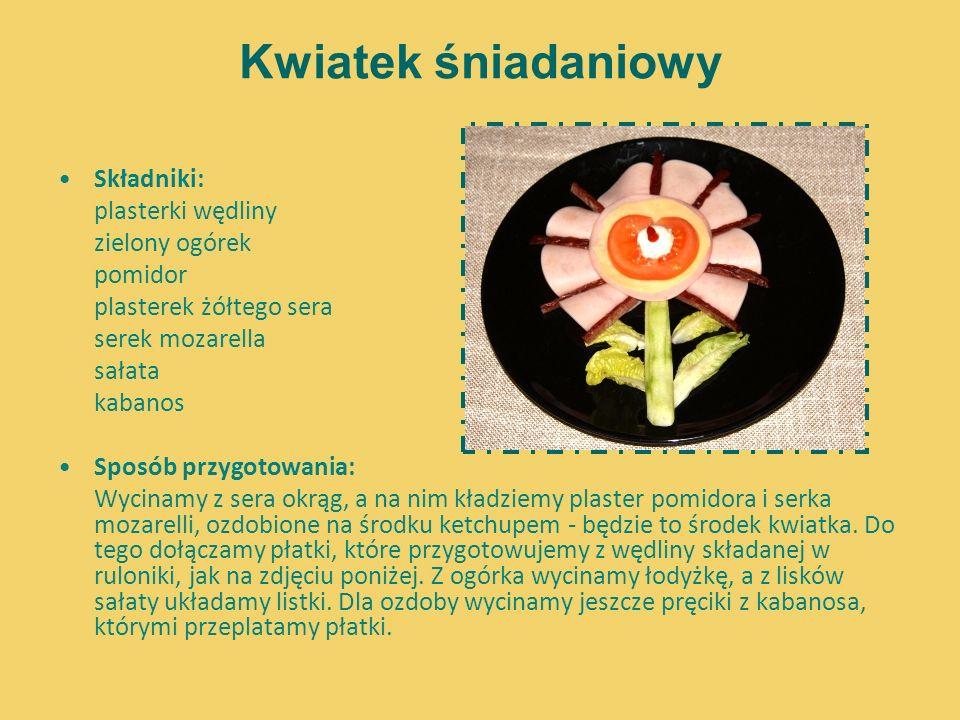 Kwiatek śniadaniowy Składniki: plasterki wędliny zielony ogórek pomidor plasterek żółtego sera serek mozarella sałata kabanos Sposób przygotowania: Wy