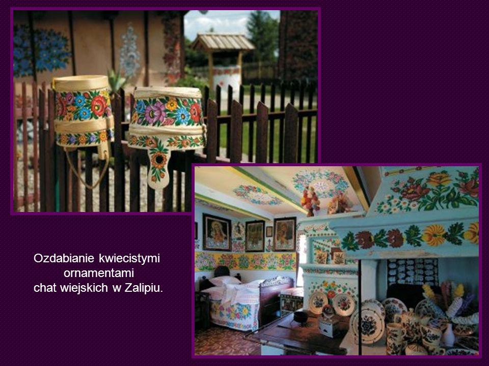 Ozdabianie kwiecistymi ornamentami chat wiejskich w Zalipiu.