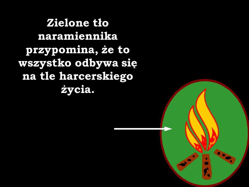 Watra na zielonym tle lewego naramiennika to symbol świadomej życiowej wędrówki po zagadnieniach i tematach z zakresu wszelakich dziedzin ludzkiej akt