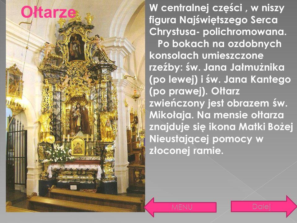W centralnej części, w niszy figura Najświętszego Serca Chrystusa- polichromowana. Po bokach na ozdobnych konsolach umieszczone rzeźby: św. Jana Jałmu