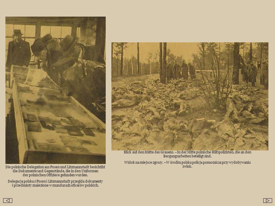 Die polnische Delegation aus Posen und Litzmannstadt besichtiht die Dokumente und Gegenstände, die in den Uniformen der polnischen Offiziere gefunden