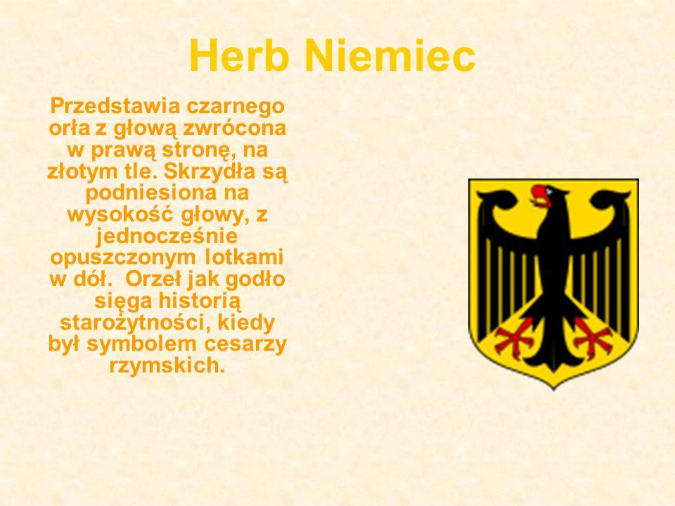 Herb Niemiec Przedstawia czarnego orła z głową zwrócona w prawą stronę, na złotym tle.