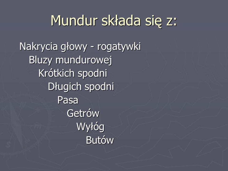 Mundur składa się z: Nakrycia głowy - rogatywki Bluzy mundurowej Krótkich spodni Długich spodni Pasa Getrów Wyłóg Butów