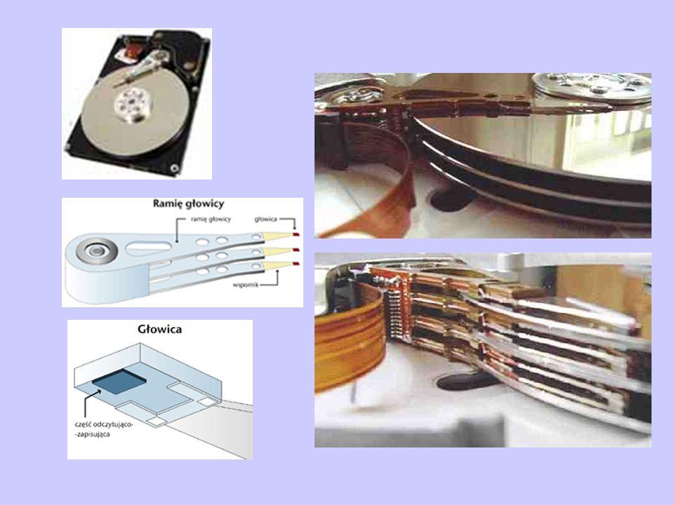 Precyzja głowica odcisk palca przekrój włosa drobinka pyłu tytoniowego powierzchnia dysku szerokość ścieżki zależnie od wysokości głowicy odległość głowicy od dysku: 0.2 – 0.07 mm (i mniej)