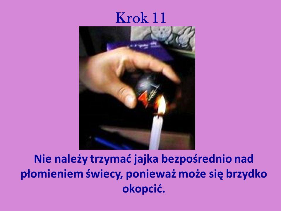 Krok 11 Nie należy trzymać jajka bezpośrednio nad płomieniem świecy, ponieważ może się brzydko okopcić.
