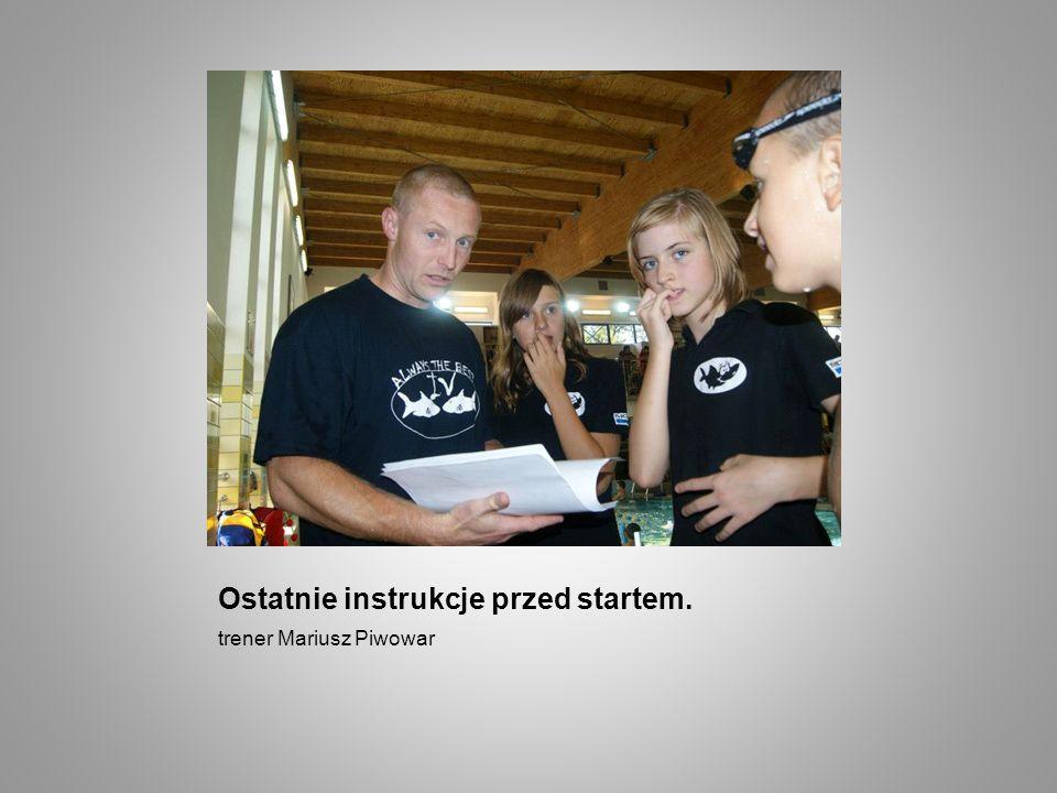 Ostatnie instrukcje przed startem. trener Mariusz Piwowar