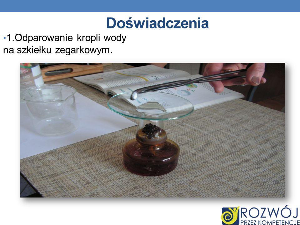 Doświadczenia 1.Odparowanie kropli wody na szkiełku zegarkowym.
