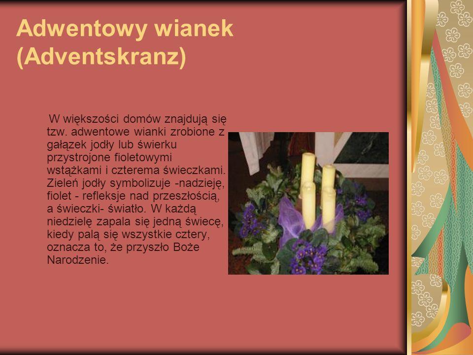 Adwentowy wianek (Adventskranz) W większości domów znajdują się tzw. adwentowe wianki zrobione z gałązek jodły lub świerku przystrojone fioletowymi ws