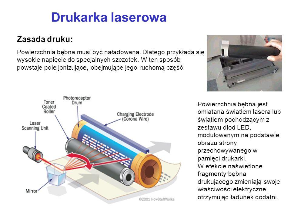 Drukarka laserowa Zasada druku: Powierzchnia bębna musi być naładowana. Dlatego przykłada się wysokie napięcie do specjalnych szczotek. W ten sposób p