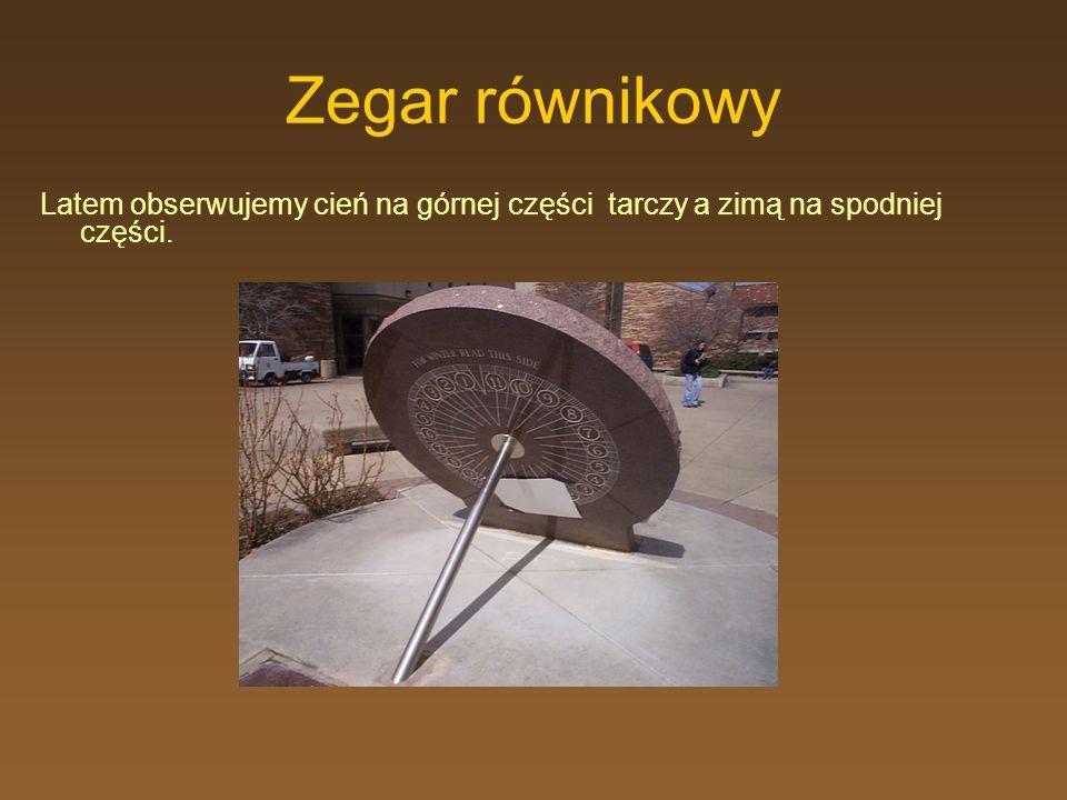 Zegar równikowy Latem obserwujemy cień na górnej części tarczy a zimą na spodniej części.