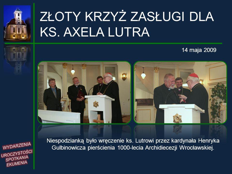 ZŁOTY KRZYŻ ZASŁUGI DLA KS. AXELA LUTRA 14 maja 2009 Niespodzianką było wręczenie ks. Lutrowi przez kardynała Henryka Gulbinowicza pierścienia 1000-le