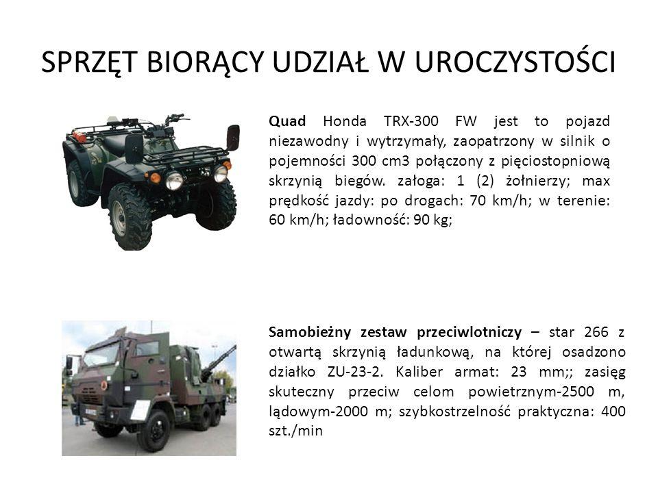 SPRZĘT BIORĄCY UDZIAŁ W UROCZYSTOŚCI Samobieżny zestaw przeciwlotniczy – star 266 z otwartą skrzynią ładunkową, na której osadzono działko ZU-23-2. Ka