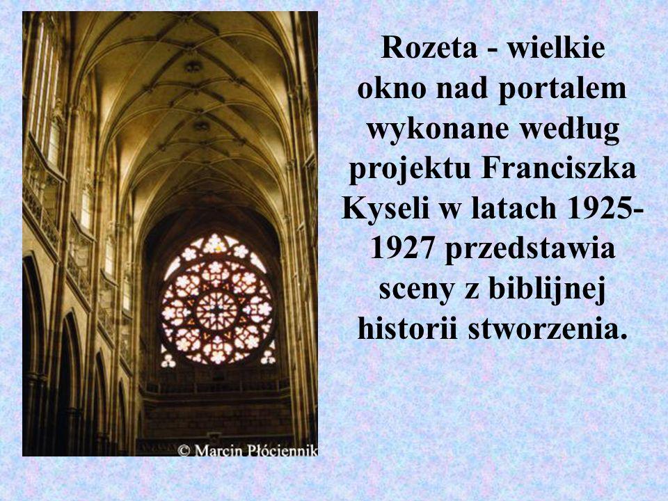 Rozeta - wielkie okno nad portalem wykonane według projektu Franciszka Kyseli w latach 1925- 1927 przedstawia sceny z biblijnej historii stworzenia.