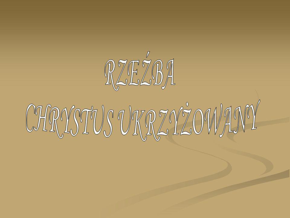 Chrzcielnica typu kielichowego z bazą w kształcie czworoboku o lekko profilowanej górnej krawędzi; trzon ozdobiony z czterech stron symetrycznym ornamentem roślinnym (akant); spłaszczony, owalny nodus w kolorze złotym łączący się ze złoconą puklowaną podstawą czaszy; czasza okrągła, zakończona u góry złotym pasem z guzami; na czaszy stożkowata pokrywa; zarówno czasza jak i pokrywa ozdobione symetrycznymi układami kwiatowo-roślinnymi w kolorze białym i zielonym; ponadto na czaszy widnieją cztery lilie, a na pokrywie cztery żółte krzyże; tło chrzcielnicy pomalowane na brązowo; w zwieńczeniu pokrywy rzeźbiona grupa Chrztu w Jordanie: klęczący Chrystus z pochyloną głową i rękami złożonymi na piersiach, karnacja ciała naturalna, włosy i broda brązowe, perizonium złote; stojący nad Chrystusem św.