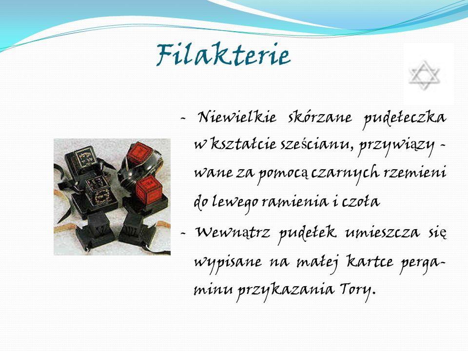 Filakterie - Niewielkie skórzane pudełeczka w kształcie sze ś cianu, przywi ą zy - wane za pomoc ą czarnych rzemieni do lewego ramienia i czoła - Wewn