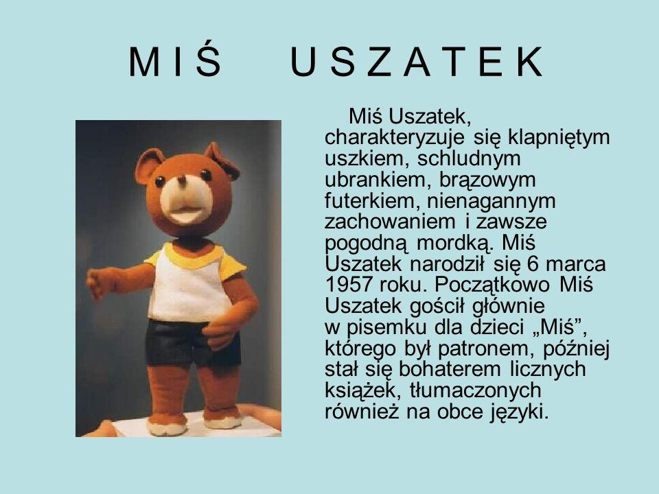 M I Ś U S Z A T E K Miś Uszatek, charakteryzuje się klapniętym uszkiem, schludnym ubrankiem, brązowym futerkiem, nienagannym zachowaniem i zawsze pogodną mordką.