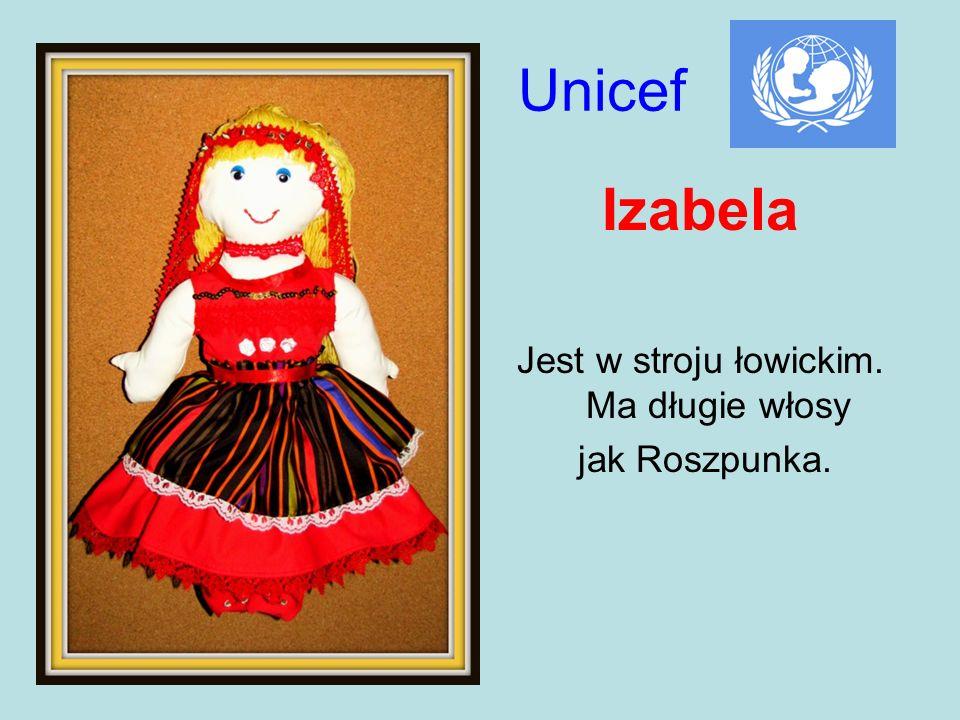 Unicef Izabela Jest w stroju łowickim. Ma długie włosy jak Roszpunka.