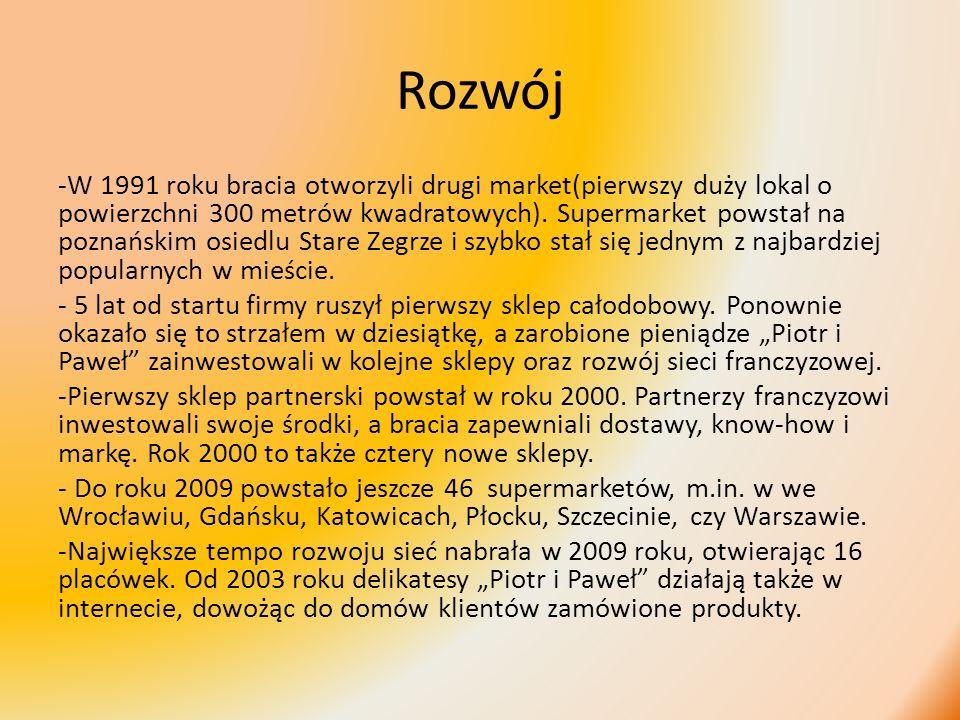 Rozwój -W 1991 roku bracia otworzyli drugi market(pierwszy duży lokal o powierzchni 300 metrów kwadratowych). Supermarket powstał na poznańskim osiedl
