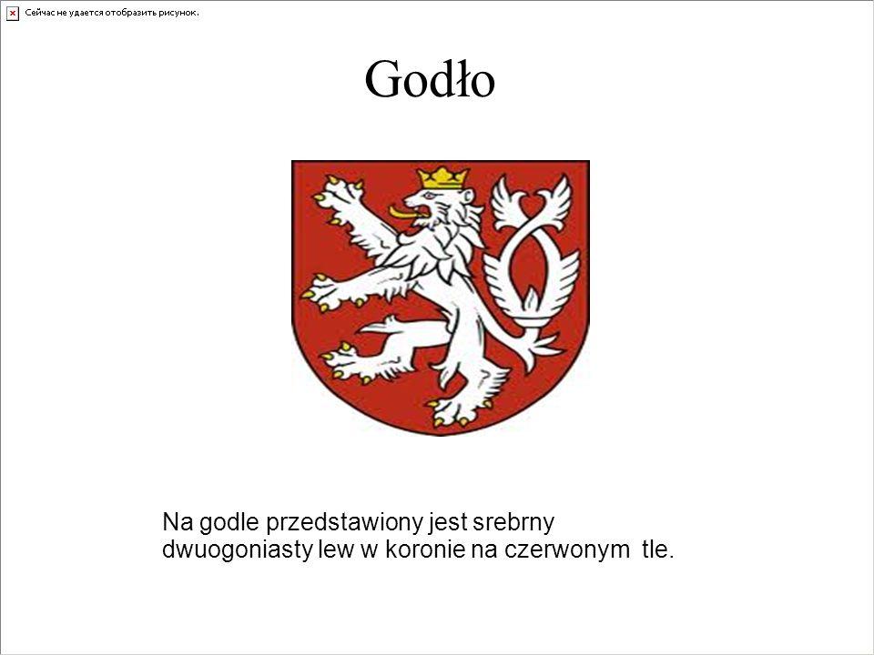 Godło Na godle przedstawiony jest srebrny dwuogoniasty lew w koronie na czerwonym tle.