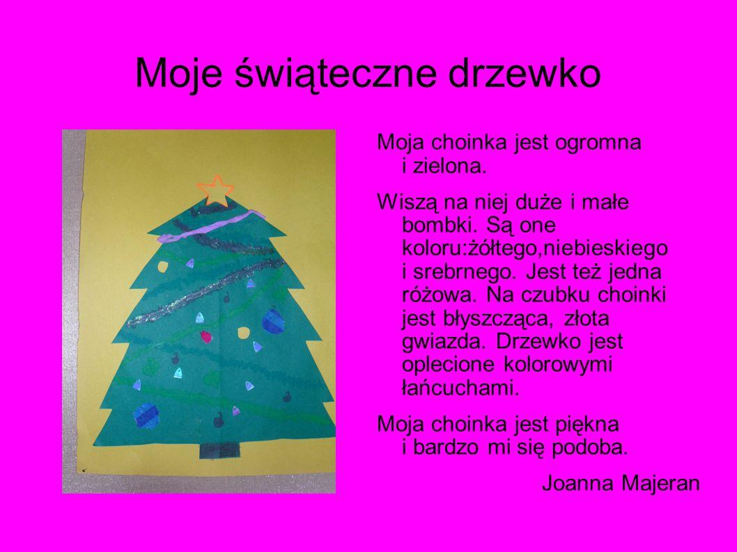 Świąteczna choinka Moje drzewko to zielona jodełka. Została ozdobiona kolorowymi bombkami. Od góry do dołu jest otoczona niebieskim łańcuchem. Czubek