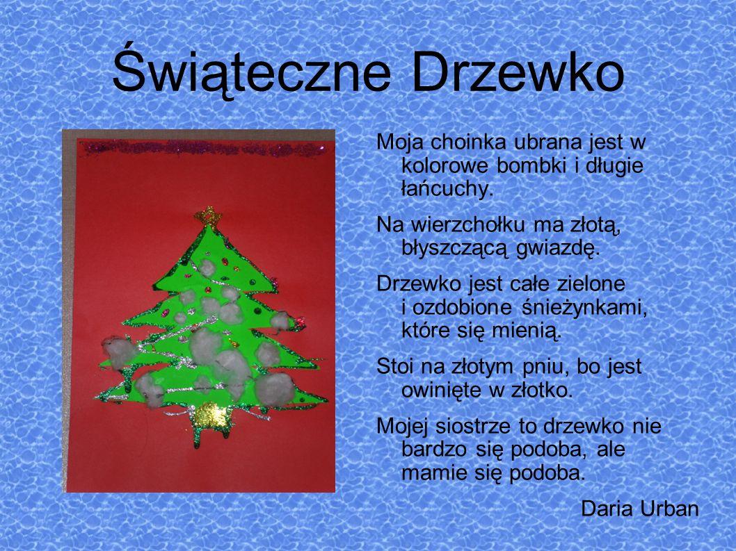Świąteczne Drzewko Moja choinka ubrana jest w kolorowe bombki i długie łańcuchy.