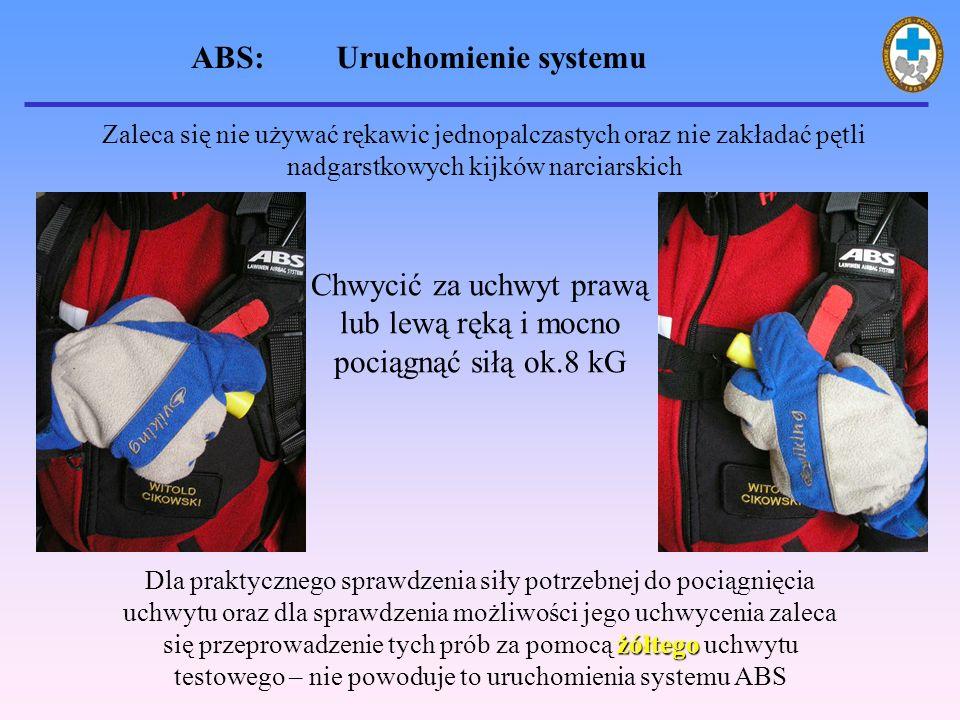 ABS: Uruchomienie systemu Zaleca się nie używać rękawic jednopalczastych oraz nie zakładać pętli nadgarstkowych kijków narciarskich Chwycić za uchwyt prawą lub lewą ręką i mocno pociągnąć siłą ok.8 kG żółtego Dla praktycznego sprawdzenia siły potrzebnej do pociągnięcia uchwytu oraz dla sprawdzenia możliwości jego uchwycenia zaleca się przeprowadzenie tych prób za pomocą żółtego uchwytu testowego – nie powoduje to uruchomienia systemu ABS