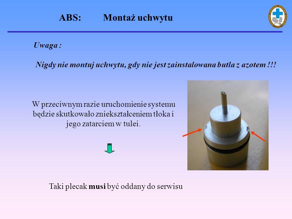 ABS: Montaż uchwytu Nigdy nie montuj uchwytu, gdy nie jest zainstalowana butla z azotem !!.