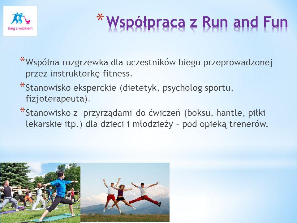 * Wspólna rozgrzewka dla uczestników biegu przeprowadzonej przez instruktorkę fitness.