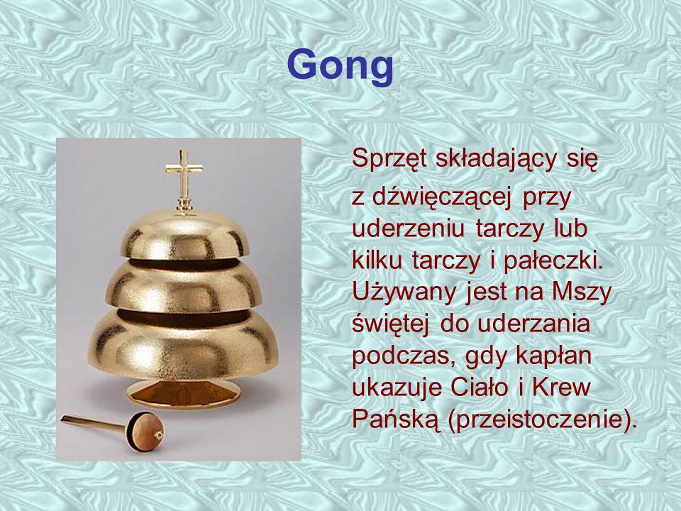 Gong Sprzęt składający się z dźwięczącej przy uderzeniu tarczy lub kilku tarczy i pałeczki. Używany jest na Mszy świętej do uderzania podczas, gdy kap