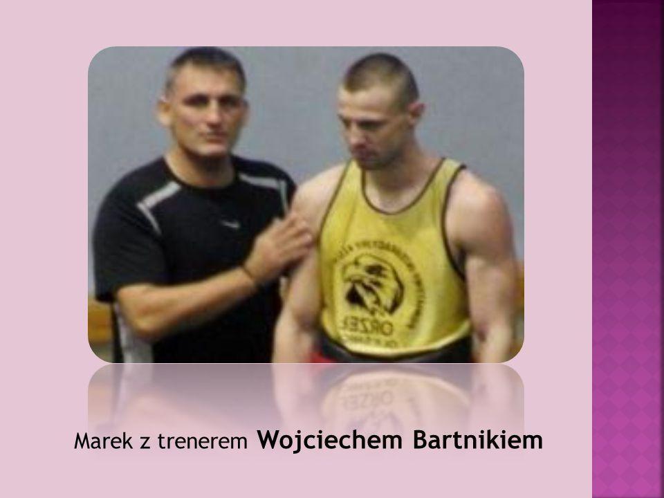 Marek z trenerem Wojciechem Bartnikiem