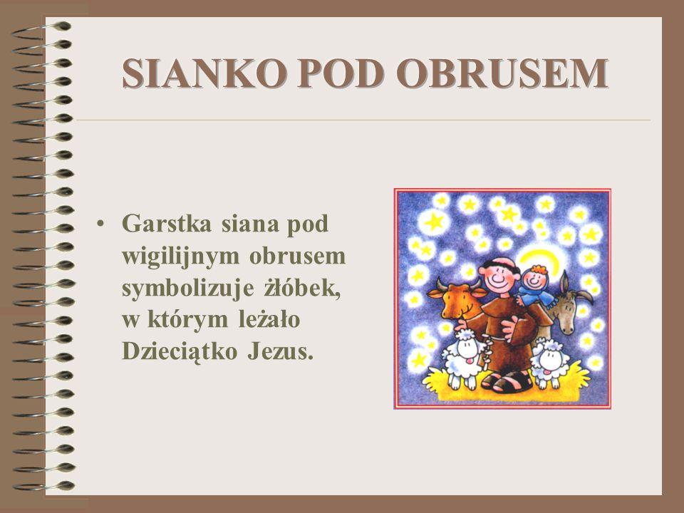 Garstka siana pod wigilijnym obrusem symbolizuje żłóbek, w którym leżało Dzieciątko Jezus.