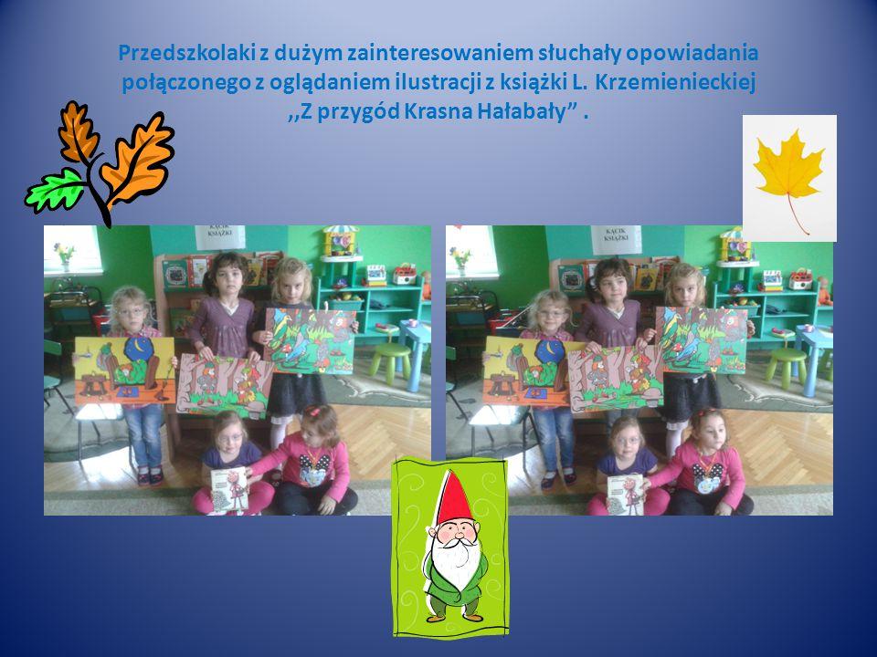 Przedszkolaki z dużym zainteresowaniem słuchały opowiadania połączonego z oglądaniem ilustracji z książki L. Krzemienieckiej,,Z przygód Krasna Hałabał