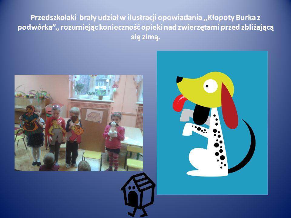 """Przedszkolaki brały udział w ilustracji opowiadania,,Kłopoty Burka z podwórka""""., rozumiejąc konieczność opieki nad zwierzętami przed zbliżającą się zi"""