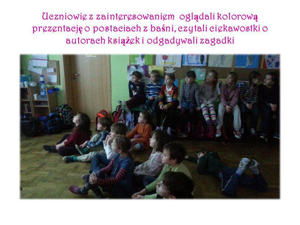 Uczniowie z zainteresowaniem ogl ą dali kolorow ą prezentacj ę o postaciach z ba ś ni, czytali ciekawostki o autorach ksi ąż ek i odgadywali zagadki