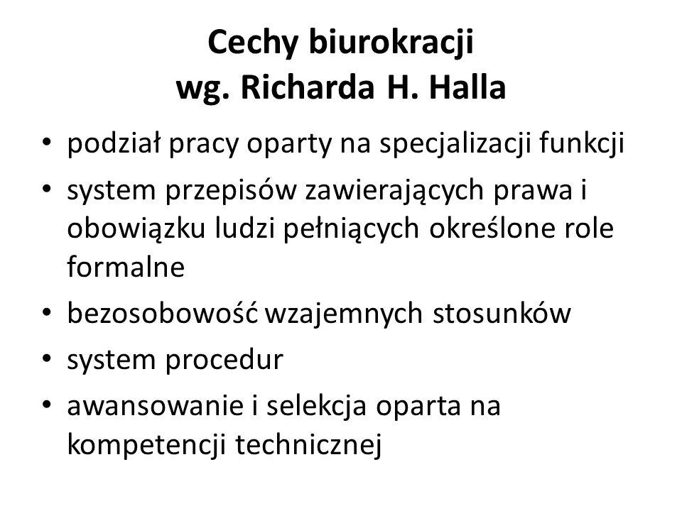 Cechy biurokracji wg. Richarda H. Halla podział pracy oparty na specjalizacji funkcji system przepisów zawierających prawa i obowiązku ludzi pełniącyc