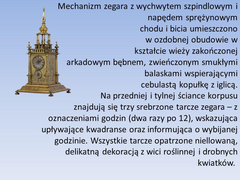 Mechanizm zegara z wychwytem szpindlowym i napędem sprężynowym chodu i bicia umieszczono w ozdobnej obudowie w kształcie wieży zakończonej arkadowym b