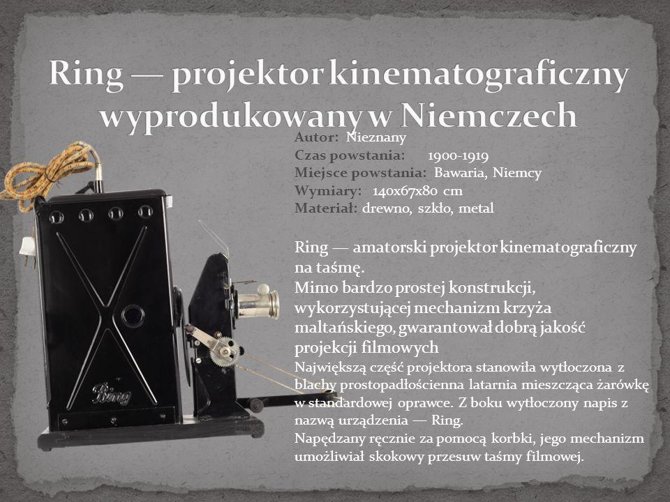 Autor: Nieznany Czas powstania:1900-1919 Miejsce powstania: Bawaria, Niemcy Wymiary: 140x67x80 cm Materiał: drewno, szkło, metal Ring — amatorski projektor kinematograficzny na taśmę.